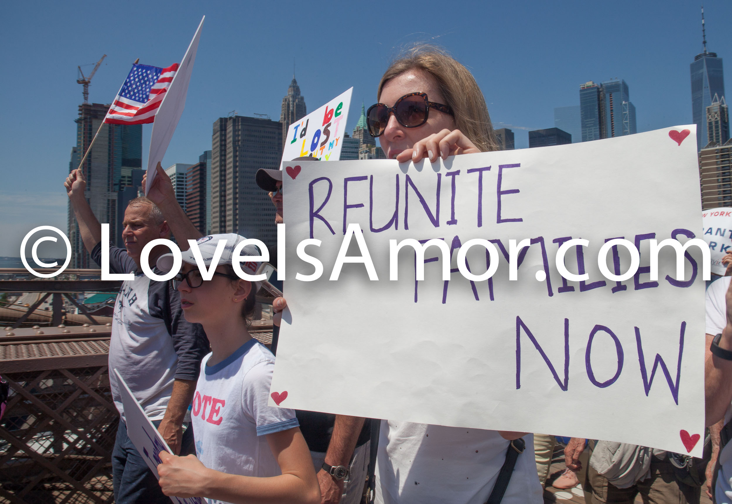 "6/30/2018. March: ""Families Belong Together."" People crossing the Brooklyn Bridge. People's protectors are marching from Foley Square in Manhattan to Cadman Plaza in Brooklyn. The sign says: ""Reunite Families Now."" Photo by Javier Soriano/LoveIsAmor.com"