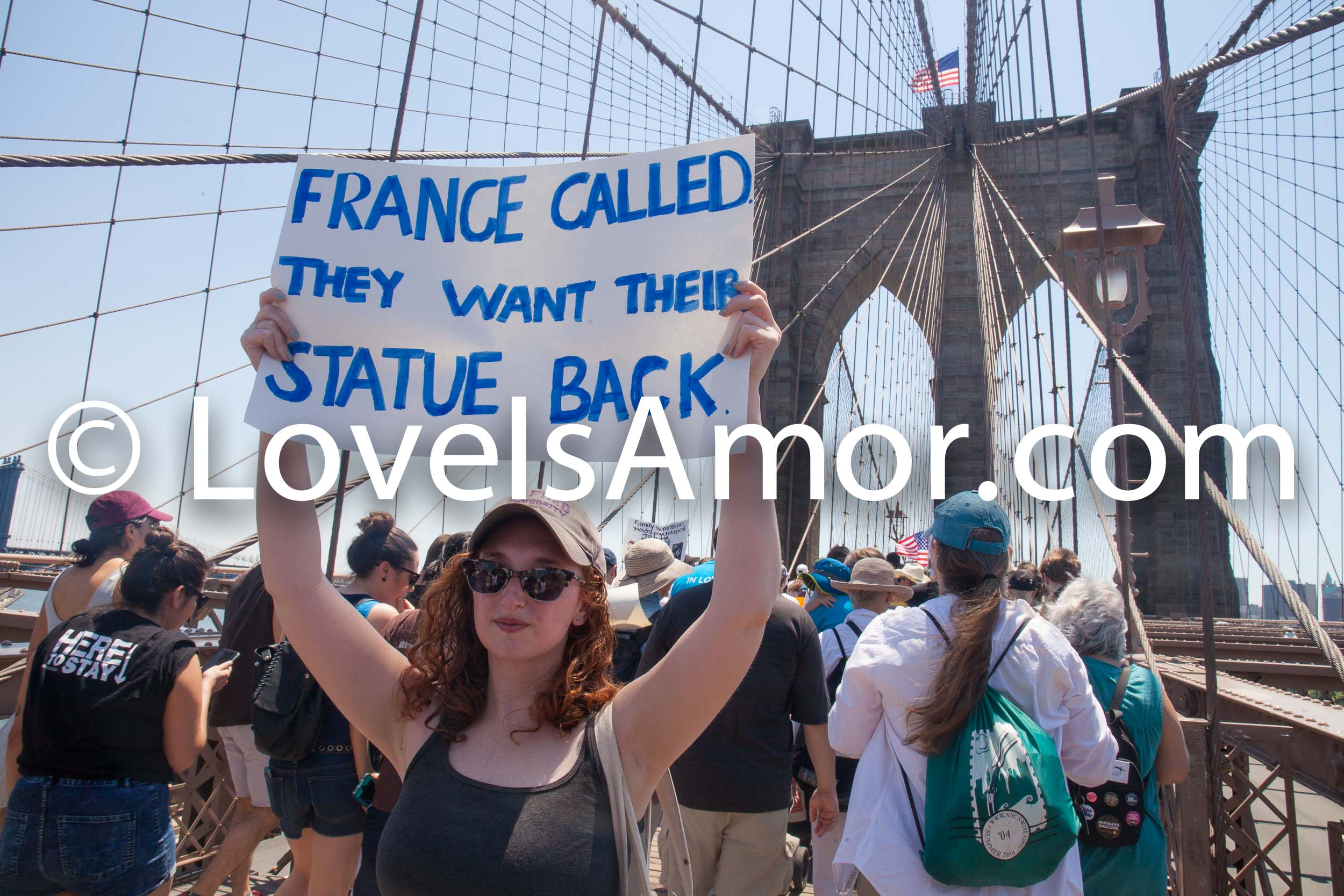 "6/30/2018. March: ""Families Belong Together."" People crossing the Brooklyn Bridge. People's protectors are marching from Foley Square in Manhattan to Cadman Plaza in Brooklyn. The sign says: ""France called. They want their statue (Statue of Liberty) back."" Photo by Javier Soriano/LoveIsAmor.com"