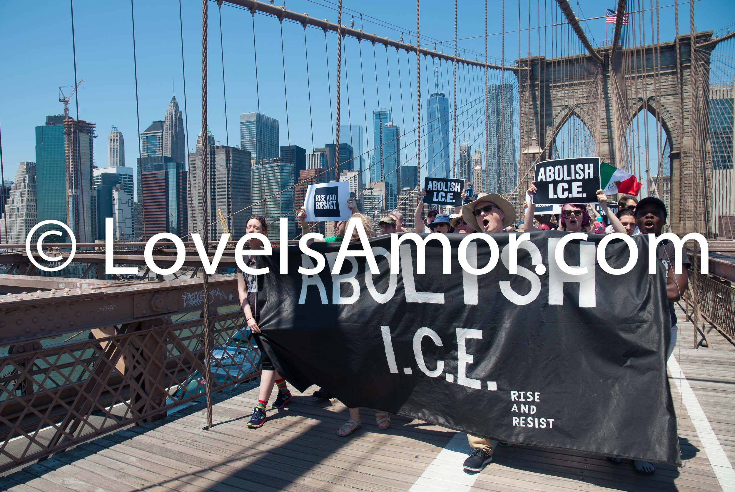 "6/30/2018. March: ""Families Belong Together."" People crossing the Brooklyn Bridge. People's protectors are marching from Foley Square in Manhattan to Cadman Plaza in Brooklyn. The sign says: ""Abolish I.C.E."" Rise and Resist Photo by Javier Soriano/LoveIsAmor.com"