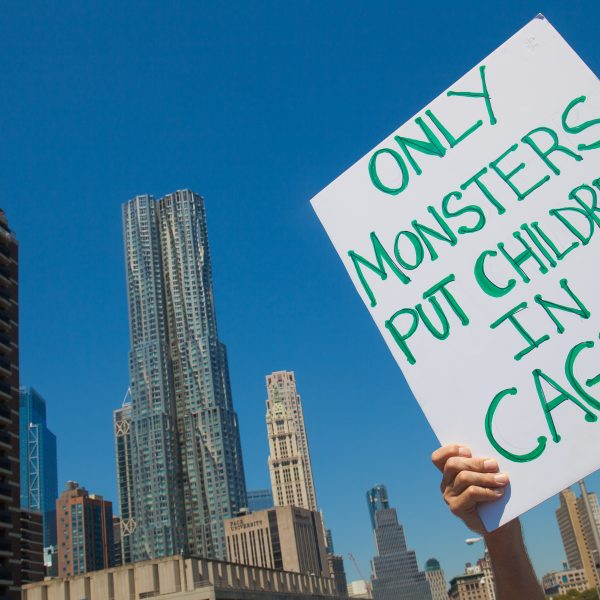 "6/30/2018. New York City - March: ""Families Belong Together."" A person with a sign that reads: ""Only monsters put children in cages."" People crossing the Brooklyn Bridge in support of refugee families. People's protectors are marching from Foley Square in Manhattan to Cadman Plaza in Brooklyn. Credit: Photo by Javier Soriano/LoveIsAmor.com"