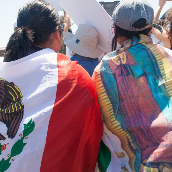"6/30/2018. New York City - March: ""Families Belong Together."" Women with Mexican flags and the Virgin of Guadalupe. People crossing the Brooklyn Bridge in support of refugee families. People's protectors are marching from Foley Square in Manhattan to Cadman Plaza in Brooklyn. Credit: Photo by Javier Soriano/LoveIsAmor.com"