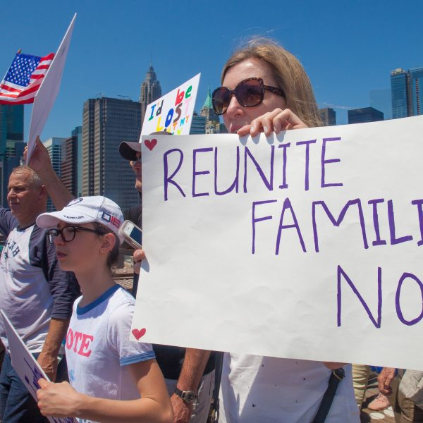 "6/30/2018. New York City - March: ""Families Belong Together."" Woman with a sign that reads: ""Reunite families now."" People crossing the Brooklyn Bridge in support of refugee families. People's protectors are marching from Foley Square in Manhattan to Cadman Plaza in Brooklyn. Credit: Photo by Javier Soriano/LoveIsAmor.com"