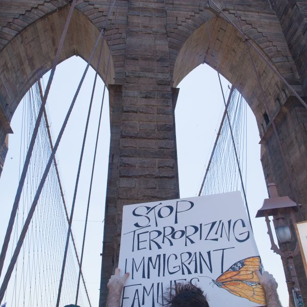 "6/30/2018. New York City - March: ""Families Belong Together."" A man with a sign that reads: ""Stop terrorizing immigrant families."" People crossing the Brooklyn Bridge in support of refugee families. People's protectors are marching from Foley Square in Manhattan to Cadman Plaza in Brooklyn. Credit: Photo by Javier Soriano/LoveIsAmor.com"
