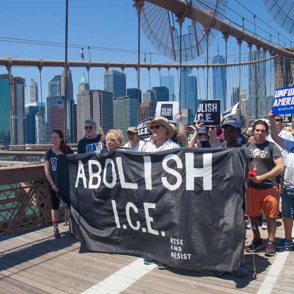 "6/30/2018. New York City - March: ""Families Belong Together."" People with a banner that reads: ""ABOLISH I.C.E. Rise and resist."" People crossing the Brooklyn Bridge in support of refugee families. People's protectors are marching from Foley Square in Manhattan to Cadman Plaza in Brooklyn. Credit: Photo by Javier Soriano/LoveIsAmor.com"