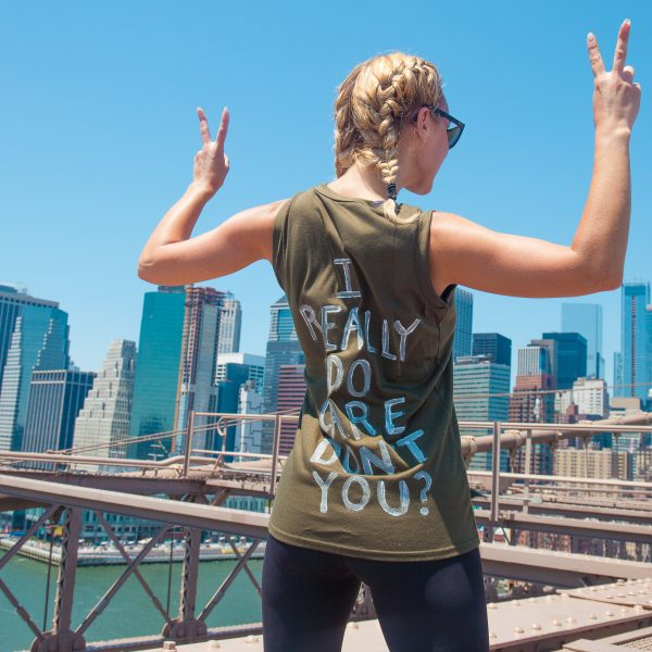 "6/30/2018. New York City - March: ""Families Belong Together."" Woman wearing a t-shirt that reads: ""I really do care. Don't you? People crossing the Brooklyn Bridge in support of refugee families. People's protectors are marching from Foley Square in Manhattan to Cadman Plaza in Brooklyn. Credit: Photo by Javier Soriano/LoveIsAmor.com"