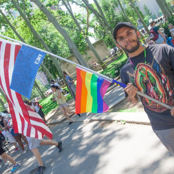 "6/30/2018. New York City - March: ""Families Belong Together."" A man with the gay flag, American flag and a t-shirt with the Virgin of Guadalupe."" People at Cadman Plaza in support of refugee families. People's protectors marched from Foley Square in Manhattan to Cadman Plaza in Brooklyn. Photo by Javier Soriano/LoveIsAmor.com"