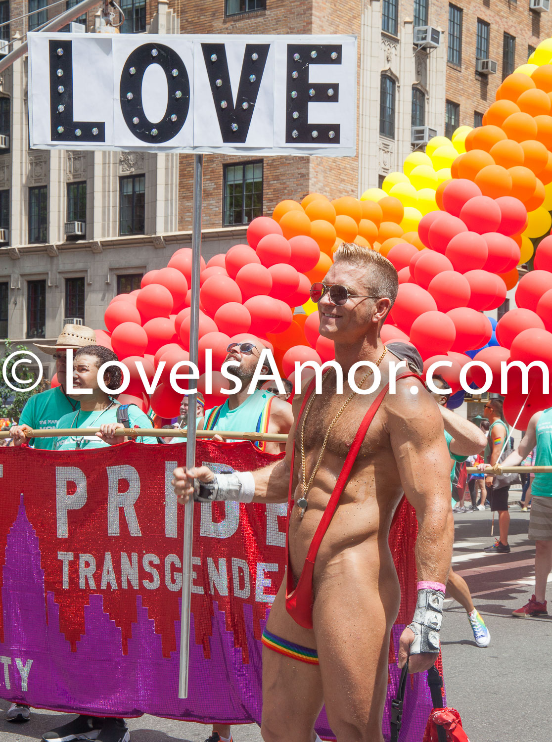 "6/24/2018. New York City – The NYC Pride March celebrated 49 years. Semi nude man. His sign says: ""LOVE."" Photo by Javier Soriano/LoveIsAmor.com"