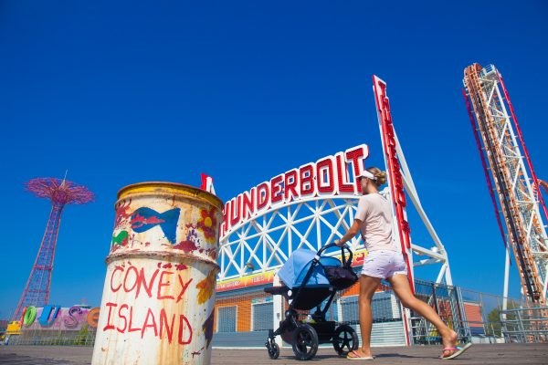 9/5/2018 Boardwalk, Parachute Jump, Thunderbolt, woman with a baby and trash can. Coney Island. Brooklyn, New York City. Credit: Photo by LoveIsAmor.com