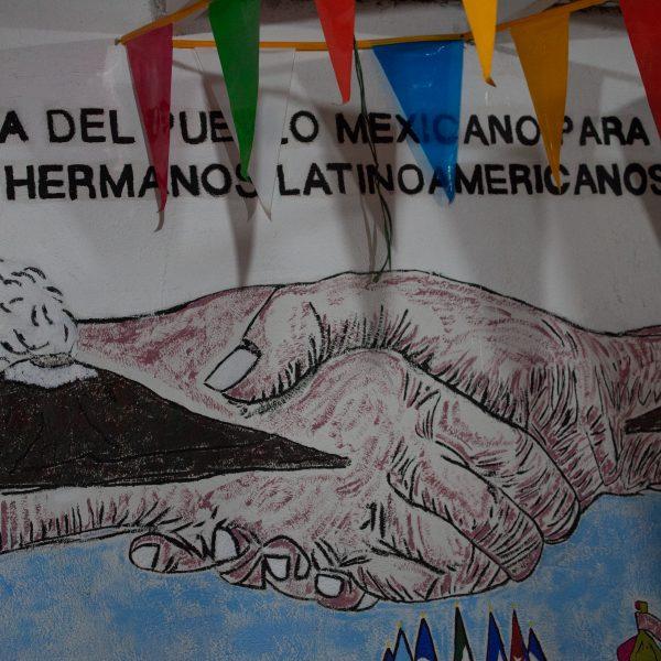 """Tlaquepaque, Guadalajara. Jalisco, Mexico. Sunday, November 18th, 2018. Mural at """"El Refugio. Casa del Migrante."""" """"Casa del pueblo mexicano para los hermanos Latinoamericanos."""" Credit: Photo by LoveIsAmor.com"""