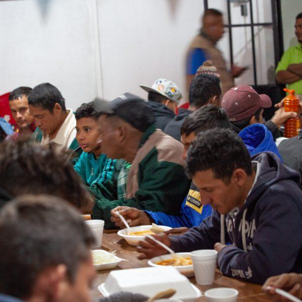 "Tlaquepaque, Guadalajara. Jalisco, Mexico. Sunday, November 18th, 2018. Refugees from Centro America having dinner at ""El Refugio. Casa del Migrante."" Volunteers prepare meals for them. Credit: Photo by LoveIsAmor.com"