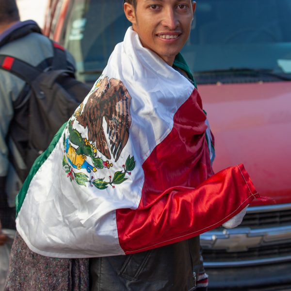 "Tlaquepaque, Guadalajara. Jalisco, Mexico. Monday, November 19th, 2018. Refugee fleeing violence and extreme poverty in Central America at ""El Refugio. Casa del Migrante."" This immigrant is from Honduras and he is part of the second caravan. He has the Mexican flag. He is grateful with Mexico. Credit: Photo by LoveIsAmor.com"