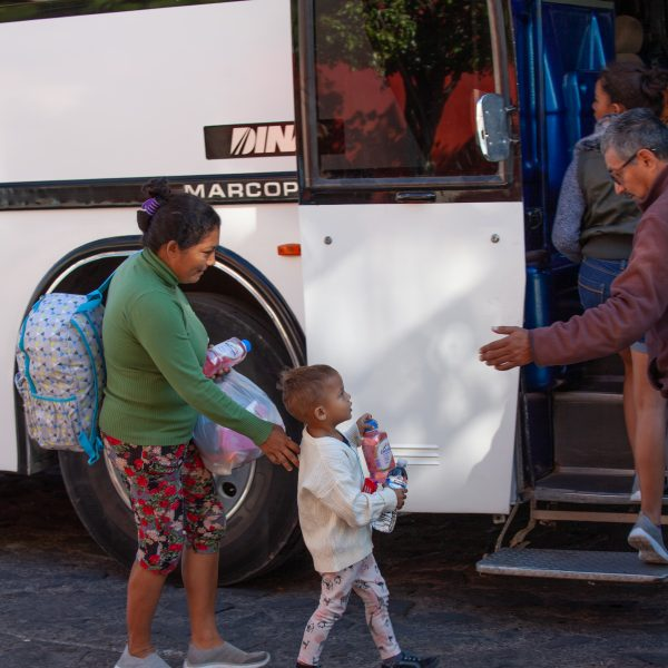 "Tlaquepaque, Guadalajara. Jalisco, Mexico. Monday, November 19th, 2018. A refugee child and his mother boarding a bus to Sinaloa. Hundreds of refugees fleeing violence and extreme poverty in Central America have been staying at ""El Refugio. Casa del Migrante"" for one or two days. These refugees are part of the second caravan. Credit: Photo by LoveIsAmor.com"