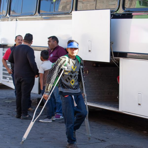 "Tlaquepaque, Guadalajara. Jalisco, Mexico. Monday, November 19th, 2018. Immigrant with crutches boarding a bus to Sinaloa. Refugees fleeing violence and extreme poverty in Central America have been staying at ""El Refugio. Casa del Migrante"" in Tlaquepaque. Refugees want to apply for asylum in the United States of America. Credit: Photo by LoveIsAmor.com"