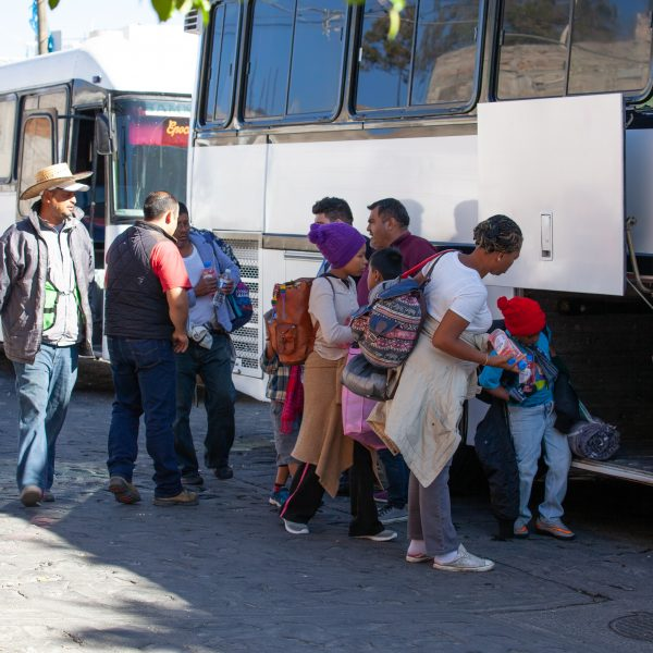 "Tlaquepaque, Guadalajara. Jalisco, Mexico. Monday, November 19th, 2018. A refugee mother and her children boarding a bus to Sinaloa. Hundreds of refugees fleeing violence and extreme poverty in Central America have been staying at ""El Refugio. Casa del Migrante"" for one or two days. These refugees are part of the second caravan. They want to apply for asylum in the United States of America. Credit: Photo by LoveIsAmor.com"