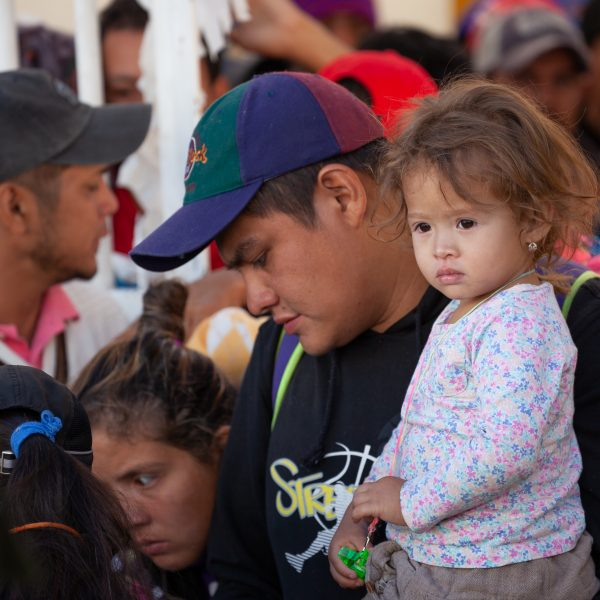 "Tlaquepaque, Guadalajara. Jalisco, Mexico. Monday, November 19th, 2018. A refugee father and his child waiting his turn to board a bus to Sinaloa. Hundreds of refugees fleeing violence and extreme poverty in Central America have been staying at ""El Refugio. Casa del Migrante"" for one or two days. These refugees are part of the second caravan. They want to apply for asylum in the United States of America. Credit: Photo by LoveIsAmor.com"