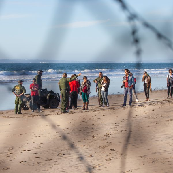 Tijuana, Baja California. Mexico. Sunday, November 25th, 2018 - Members of the Democratic Socialists Of America (DSA) gave water to immigrants from Centro America at the Mexico - US border. US border agents ordered them to move away from the fence. Credit: Photo by LoveIsAmor.com