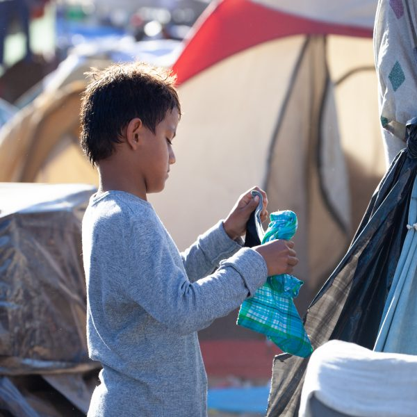 Tijuana, Baja California. Mexico. Monday, November 26th, 2018. A little boy refugee at Unidad Deportiva Benito Juárez (an improvised shelter for the caravans of immigrants). Refugees are fleeing violence and extreme poverty in their countries in Central America. They want to apply for asylum in the United States of America. Credit: Photo by LoveIsAmor.com