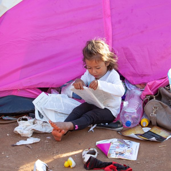 Tijuana, Baja California. Mexico. Monday, November 26th, 2018. A little girl refugee at Unidad Deportiva Benito Juárez (an improvised shelter for the caravans of immigrants). Refugees are fleeing violence and extreme poverty in their countries in Central America. They want to apply for asylum in the United States of America. Credit: Photo by LoveIsAmor.com