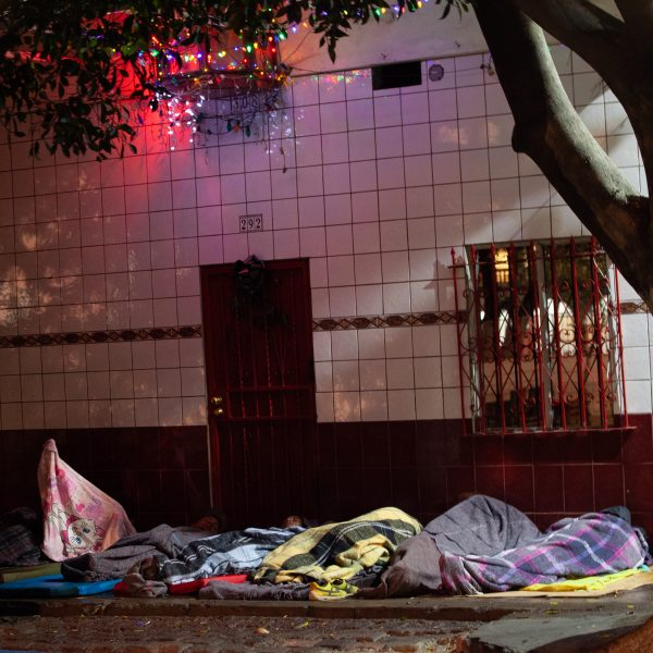 Tijuana, Baja California. Mexico. Thursday, November 29th, 2018. Refugees sleeping outside Unidad Deportiva Benito Juárez (an improvised shelter for the caravans of immigrants). It was raining last night. They do not have a tent. Refugees are fleeing violence in their countries in Central America. They want to apply for asylum in the United States of America. Credit: Photo by LoveIsAmor.com
