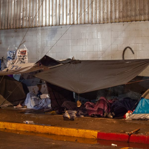 Tijuana, Baja California. Mexico. Thursday, November 29th, 2018. Refugees sleeping outside Unidad Deportiva Benito Juárez (an improvised shelter for the caravans of immigrants). It was raining last night and it was raining all day today. Refugees are fleeing violence in their countries in Central America. They want to apply for asylum in the United States of America. Credit: Photo by LoveIsAmor.com