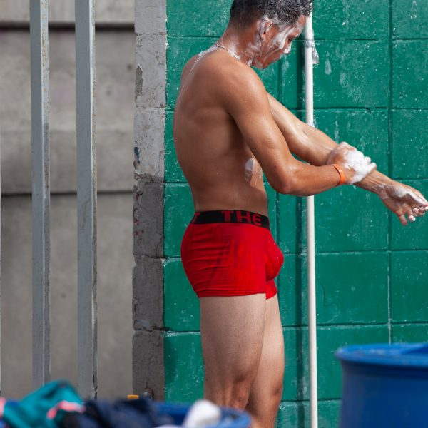 Tijuana, Baja California. Mexico. Thursday, November 29th, 2018. Refugee man taking a shower at Unidad Deportiva Benito Juárez (an improvised shelter for the caravans of immigrants). Refugees are fleeing violence and extreme poverty in their countries in Central America. They want to apply for asylum in the United States of America. They were told they have to wait more than a month to apply for asylum. Credit: Photo by LoveIsAmor.com