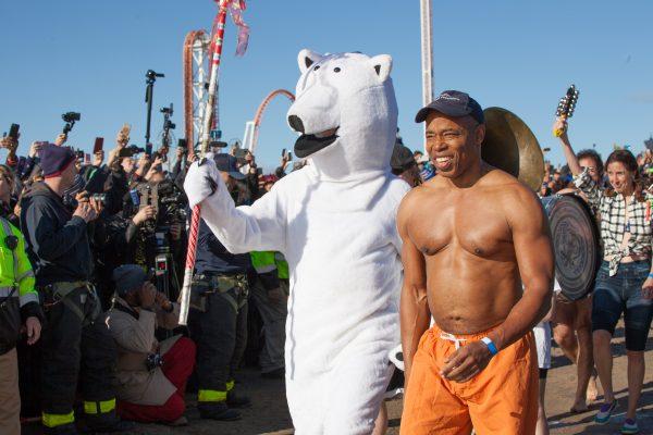 Coney island, Brooklyn. New York City. Tuesday, January 1, 2019 - Today was the New Year's Day Polar Bear Plunge at Coney Island, New York City. The shirtless Black man is Eric Leroy Adams, the Borough President of Brooklyn. Credit: Photo by LoveIsAmor.com