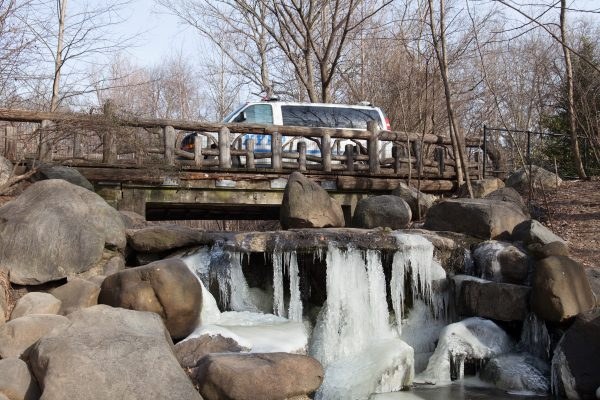 Brooklyn, New York City. Saturday, February 2, 2019 - A waterfall in Prospect Park is frozen. A NYPD van is crossing the bridge. Credit: Photo by LoveIsAmor.com
