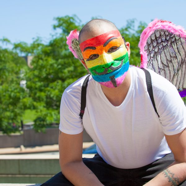 Sunday, June 23rd, 2019. Bronx, New York City - Today was the 1 Bronx World Pride Rally, March and Festival. Today people celebrated Bronx World Pride, Pride Month and the 50th anniversary of the Stonewall Rebellion. This Latino man was one of the attendees who came to celebrate Bronx World Pride, Pride Month and the 50th anniversary of the Stonewall rebellion. He was wearing a rainbow mask and a rainbow wings. Credit: Photo by LoveIsAmor.com