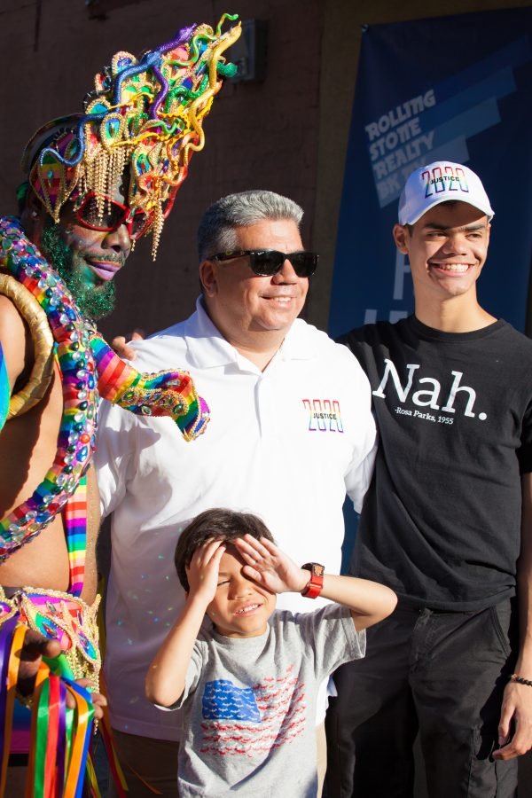 Saturday, June 8th, 2019. Brooklyn, New York City - Brooklyn District Attorney Eric Gonzalez, his sons and a Black man wearing a beautiful costume at the Brooklyn Pride Parade/March. This year, Brooklyn celebrated the 23rd Annual Brooklyn Pride Parade/March. Brooklyn Pride was ranked within the top 10 of the 20 best places in the US to celebrate pride by matadornetwork.com. This year is the 50th anniversary of the Stonewall revolution. Credit: Photo by LoveIsAmor.com