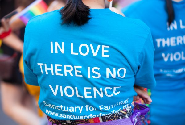 "Saturday, June 8th, 2019. Brooklyn, New York City - Sanctuary for Families activists at the Brooklyn Pride Parade/March. Their t-shirt says: ""IN LOVE THERE IS NO VIOLENCE"". This year, Brooklyn celebrated the 23rd Annual Brooklyn Pride Parade/March. Brooklyn Pride was ranked within the top 10 of the 20 best places in the US to celebrate pride by matadornetwork.com. This year is the 50th anniversary of the Stonewall revolution. Credit: Photo by LoveIsAmor.com"