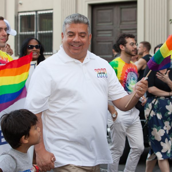 Saturday, June 8th, 2019. Brooklyn, New York City - Brooklyn District Attorney Eric Gonzalez, his son and other people at the Brooklyn Pride Parade/March. This year, Brooklyn celebrated the 23rd Annual Brooklyn Pride Parade/March. Brooklyn Pride was ranked within the top 10 of the 20 best places in the US to celebrate pride by matadornetwork.com. This year is the 50th anniversary of the Stonewall revolution. Credit: Photo by LoveIsAmor.com